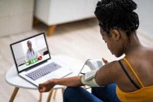 Telemedicine in Nigeria - Lady Accessing care through the laptop.